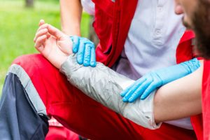 EMT wrapping up the arm of a burn victim | Wisconsin Burn Injury Lawyers