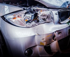 Detail Of The Front Of A Luxury Car That Has Crashed | Milwaukee Uninsured Motorist Accident Attorneys
