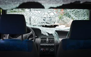 Interior of car with smashed, shattered windshield | Milwaukee Car Accident FAQ