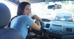 happy teen girl driving car | Crash Rates for Teen Drivers in Wisconsin