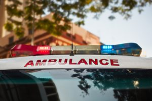 close up of ambulance with sirens and lights on the street | Milwaukee Hit and Run Accident Attorneys