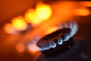 blue flame coming from cicrular gas stove burner | milwaukee Gas Explosion Lawyers
