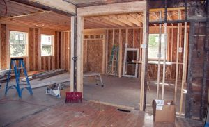interior of room being built in house under construction with blue ladder and wooden wall frames | Milwaukee Home Improvement Fraud Lawyers