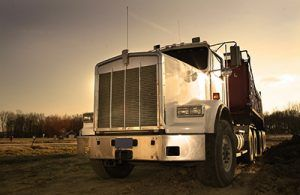 sepia toned image of a semi truck from the front | Milwaukee Trucking Accident Lawyers