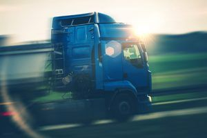 cab of a blue semi in motion against the sunset | After a Trucking Accident